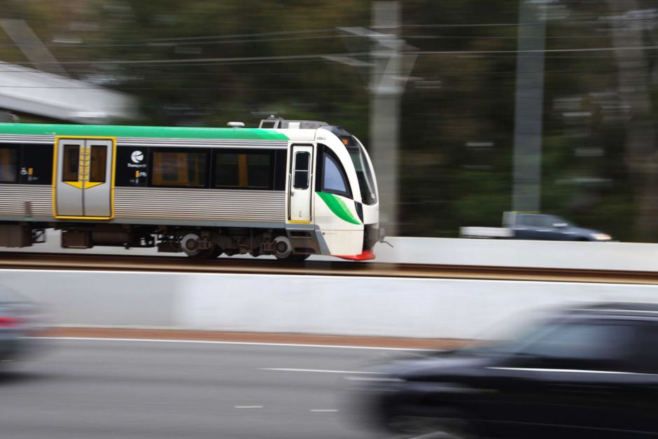 A transperth train zooms along the railway line, making for the perfect blurred action shot.